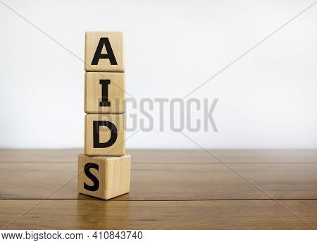 Symbol For Helping People With Aids, Acquired Immunodeficiency Syndrome. Turned A Wooden Cube With W