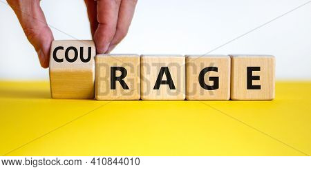 Rage Or Courage Symbol. Businessman Turns A Cube And Changes The Word 'rage' To 'courage'. Beautiful
