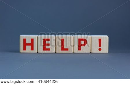 Support And Help Symbol. Wooden Cubes With The Word 'help'. Business, Psychology, Support And Help C