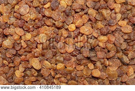 Background Made Of Mixed Brown Raisins. Top View. Raisins Backdrop. Healthy Snack And Food. Dry Grap