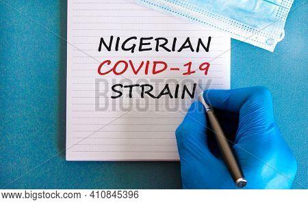 New Covid-19 Nigerian Strain Symbol. Hand In Blue Glove With White Card. Concept Words 'nigerian Cov