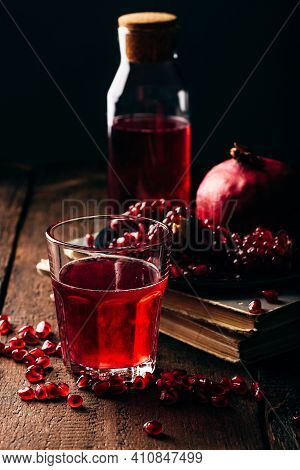 Glass Of Infusion With Freshly Squeezed Pomegranate Juice