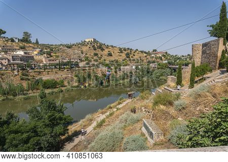 Toledo, Spain, July 2020 - View Of A Man On A Zipwire Over The River Tagus At Toledo, Spain