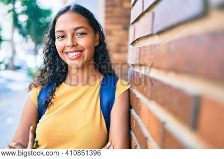 Young african american student girl smiling happy at university campus.