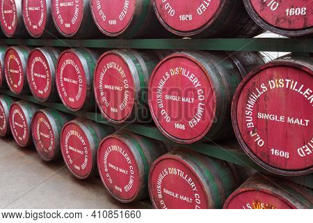 Bushmills, Northern Ireland - June 208, 2017: Barrels with single malt whiskey in Old Bushmills Distillery. The distillery is a popular tourist attraction, with around 120,000 visitors per year.
