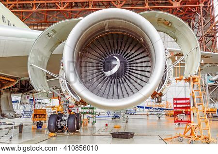 Industrial Conceptual Theme View. Repair And Maintenance Of Aircraft Engine With Open Hoods On The W