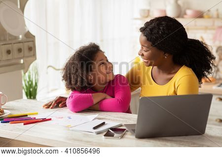 Upbringing Concept. Portrait Of Happy African American Mom And Daughter Spending Time Together In Ki