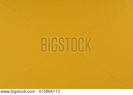 Yellow Paper Background. Goldenrod Orange Colour Paper Texture. Matte Monochrome Surface.