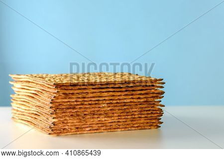 Matzah On White Table Over Blue Background.matza -jewish Traditional Passover Unleavened Bread. Pesa