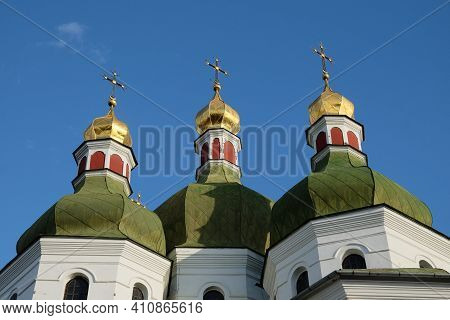 Domes Of An Orthodox Church Against The Sky. Orthodox Baroque Architecture. Clear Sky. An Old Religi