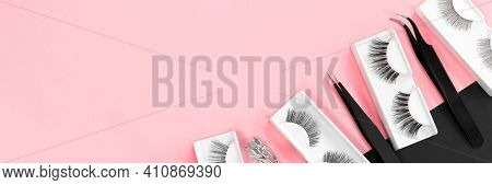 Various Tools For Eye Lash Extensions On A Trendy Pastel Pink And Black Background. Banner. Concept.