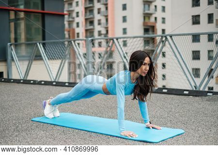 Attractive Woman Do Plank Exercise on Fresh Air