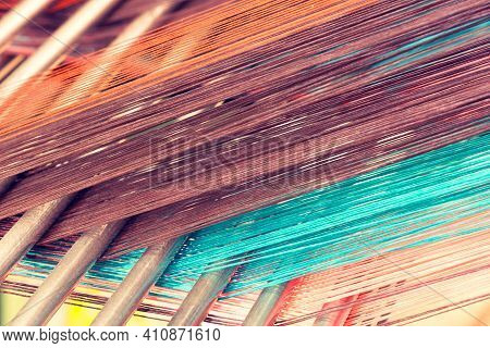 Multicolored Straight Strands Texture Background, Sewing Equipment, Loom Equipment At A Garment Fact