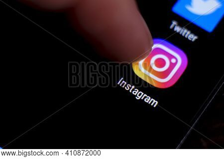 Madrid, Spain- March 3, 2021: Finger Pressing Instagram Icon On Black Mobile Phone Screen. Twitter I