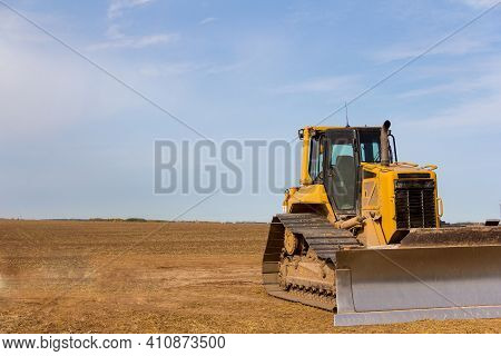 Close-up View Of Heavy Bulldozer. Construction Machinery. Bulldozer On The Construction Of A New Roa