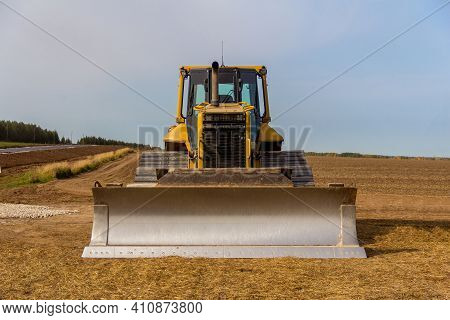 Close-up View Of Heavy Bulldozer. Construction Machinery. Bulldozer On The Construction Of A New Roa