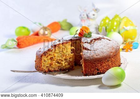 Traditional Carrot Cake Decorated With Powdered Sugar, Carrot Flower And Mint. Concept Of Desserts F