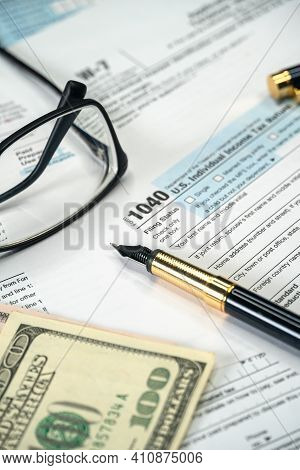 Filling Us Tax Form 1040. Tax Time For Usa Business Income Return Tax And Irs. Vertical Photo