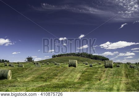 Round Hay Bales On A Canadian Prairies Harvested Field In Rocky View County Alberta.