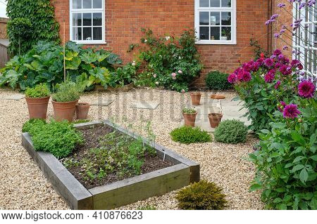 Oak Sleeper Raised Beds In A Hard Landscaped Courtyard Garden With Gravel,  York Stone Paving And Te