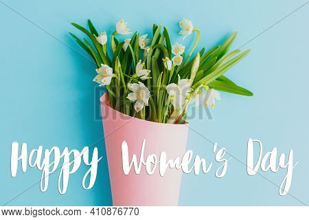 Happy Womens Day Greeting Card. Stylish Handwritten Text Sign On Spring Flowers Bouquet In Pink Pape