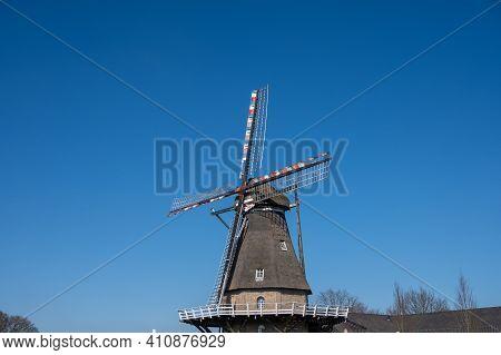 Old Dutch Grain Wind Mill In Veldhoven, North Brabant, Netherlands
