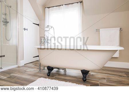 Bathtub, Clawfoot Or Clawfoot Bath Tub In A Modern Luxury Bathroom Interior, Uk. Bath Time.