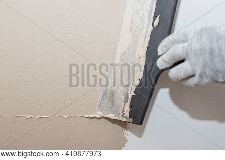 Hand Of Builder Worker Plastering At Wall.renovation Workers Hand Plastering The Wall.construction F