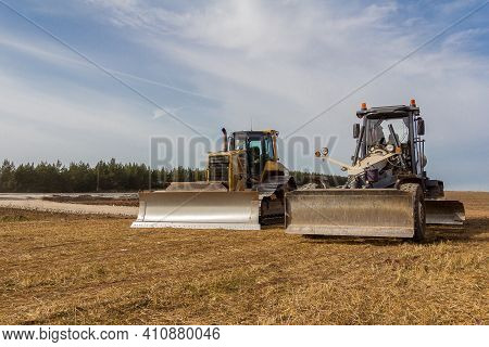 Road Grader And Bulldozer On The Construction Of A New Road. Construction Machinery. Dedicated Const
