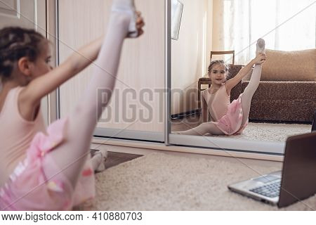 Pretty Young Ballerina Practicing Classic Choreography During Online Class In Ballet School, Social