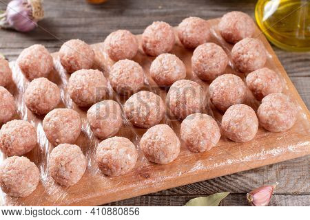 Semi-finished Products, Raw Meatballs, Meat Patties On A Cutting Board On A Wooden Table