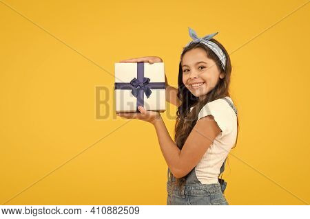 Child Smiling Happy Hold Gift Box. Kid Girl Delighted Gift. Unexpected Surprise. Thank You. Celebrat