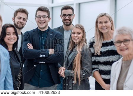 Smiling and confident business team standing together