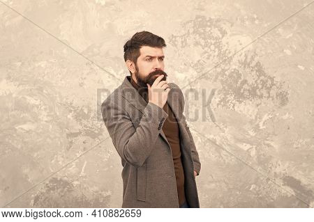 Male Beauty Standards. Menswear Concept. Elegant And Stylish Hipster. Bearded Man Thinking Outdoor.