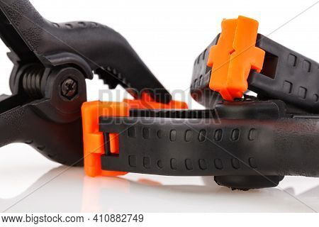 Plastic Spring Clamp Isolated On White Background. Clamping Equipment. Working Hand Tool. Black And