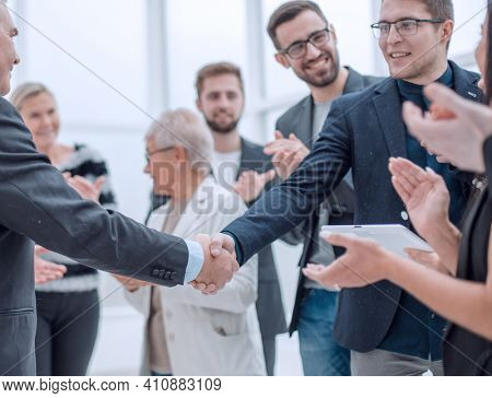 Businessteam is introducing a colleague to another businessman