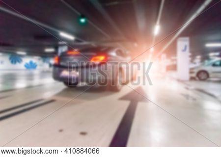 Parking Car Blurred. Empty Road Asphalt Background In Soft Focus. Car Lot Parking Space In Undergrou