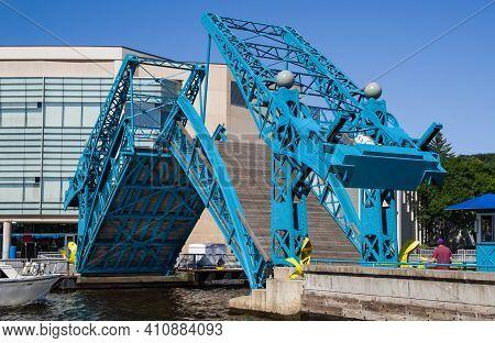 Pedestrian Drawbridge:  The Sides Of A Foot Bridge Tilt Upward To Allow Passage Of Boats Through The