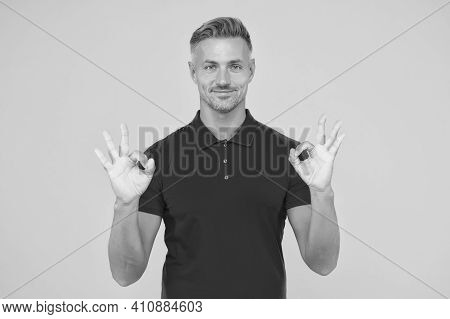 Satisfactory Result. Happy Man Show Double Ok Signs Yellow Background. Satisfied Guy Smile With Sati
