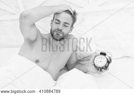 Man Sleeping Bed White Bedclothes And Red Alarm Clock, Lack Of Sleep Concept.