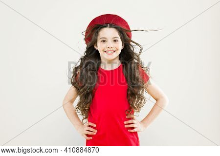 Happy Girl With Long Curly Hair In Beret. Little Girl In French Style Hat. Summer Fashion And Beauty
