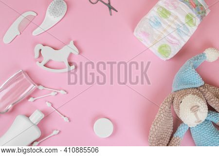 Baby Accessories On Pink Background, Flat Lay. Composition With Baby Accessories And Space For Text.