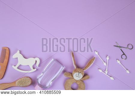 Baby Accessories On Lavender Background, Flat Lay. Composition With Baby Accessories And Space For T