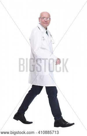 man doctor striding forward confidently . isolated on a white background.
