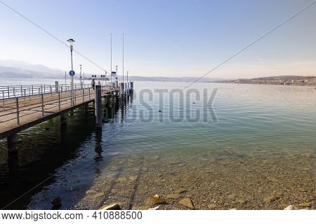 Empty Pier Without Ships On The Lake In Bright Sunshine, At This Landing Pier People Can Take A Boat