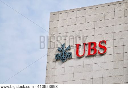 Zug, Switzerland - 26th February 2021 : Ubs Bank Logo Sign Hanging On A Building Facade In Zug. Ubs