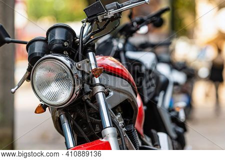 A Row Of Motorcycles Parked On The Side Of The Street, Close-up Of Details, Soft Focus, Urban Backgr