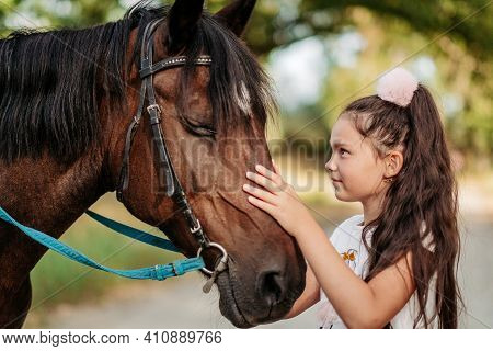 Emotional Contact With The Horse. Horse Riding. The Girl Rides A Horse In The Summer.
