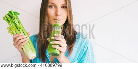 Healthy Detox Vegan Diet. Young Beautiful Woman Holding Bunch Of Fresh Celery Stalk And Drinking Fre