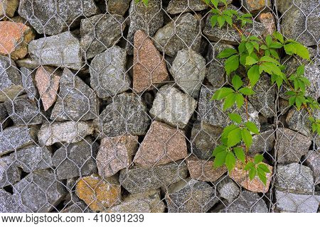 Gabion, Texture, Background. Wall Made Of Natural Rocks And Metal Fences.